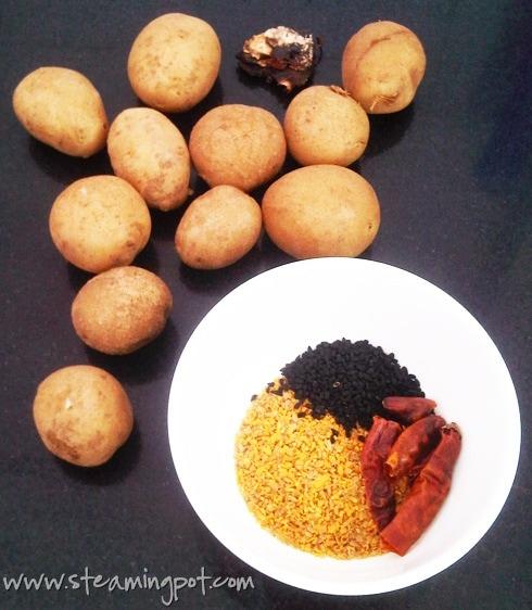 ... of tamarind, nigella seeds, dry red chilies, cracked fenugreek seeds