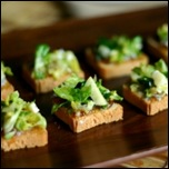 Shredded Brussels sprouts on mini-toasts