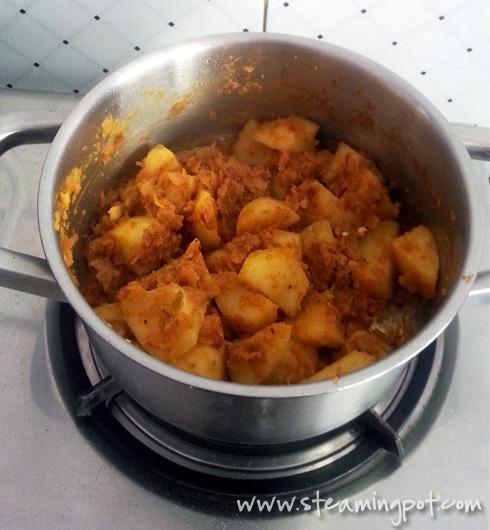 Potatoes Cooking in Onion Tomato Gravy