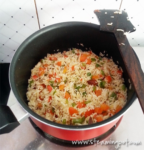 Rice Cooked with Green and Red Bell Peppers