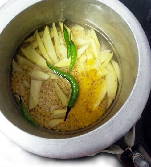 Dal, Raw Mango, Green Chilies, Garlic In Pressure Cooker